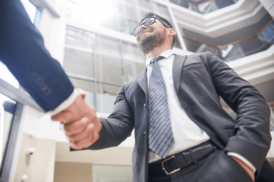 firm handshake of business partners RXLH8TK 1 1